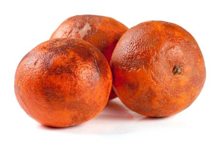three damaged tangerine isolated on white background Stock Photo