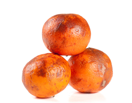three damaged tangerine isolated on white background Stock Photo