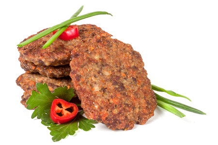 ovine: liver pancakes or cutlets with chili pepper parsley and green onions isolated on white background