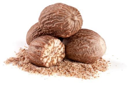 four nutmeg and powder isolated on white background Stock Photo