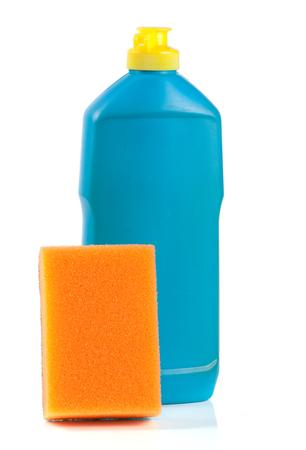 lavar platos: dishwashing detergent with sponge isolated on white background Foto de archivo