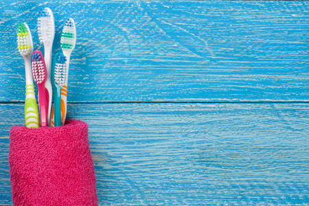 manual toothbrushes on the blue wooden background with copy space for your text. Top view. Stock Photo