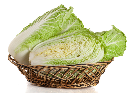 bok choy: Chinese cabbage in a wicker basket isolated on white background Stock Photo