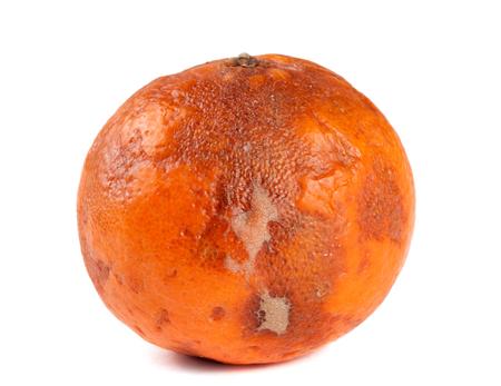 one damaged tangerine isolated on white background