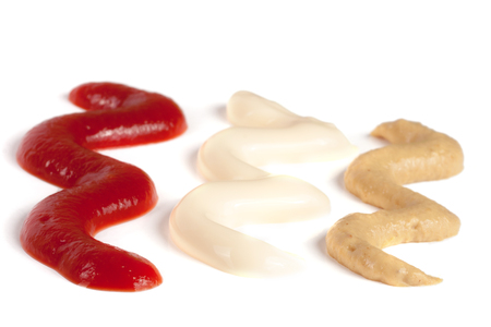 Ketchup mayonnaise and mustard isolated on white background. Stock Photo
