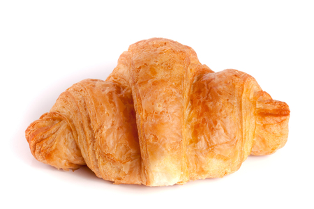 buttery: one croissant isolated on white background closeup. Stock Photo