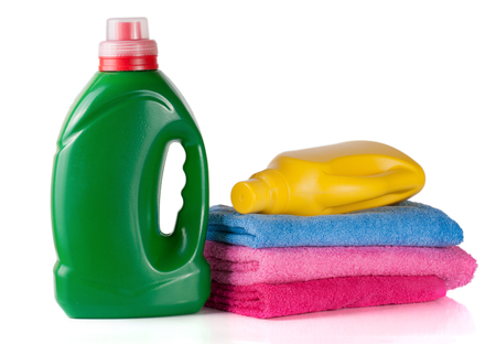 white washed: bottle laundry detergent and conditioner or fabric softener with towels isolated on white background