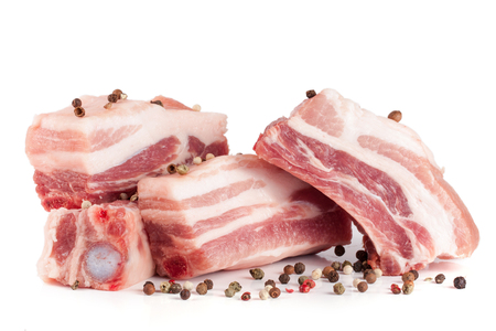 pieces of pork with peppercorn isolated on white background Stock Photo