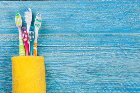 toothbrushes on the blue wooden background with copy space for your text. Top view Stock Photo
