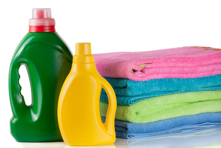 white washed: bottle laundry detergent and conditioner with towels isolated on white background