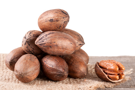 pekan: a bunch of pecan nuts on the old board with white background