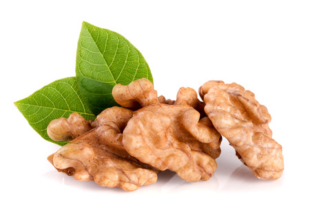 cleaned: Walnuts with leaf isolated on white background Stock Photo