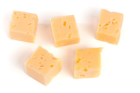 cheese cut into cubes isolated on white background