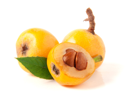 Ripe loquat or Eriobotrya japonica with leaf isolated on white background Stock Photo