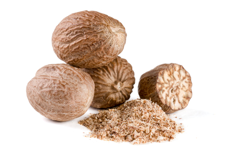 Three nutmeg and powder isolated on white background.