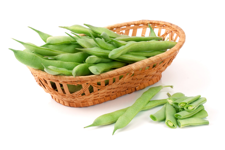 long bean: Green beans in a wicker basket isolated on a white background.