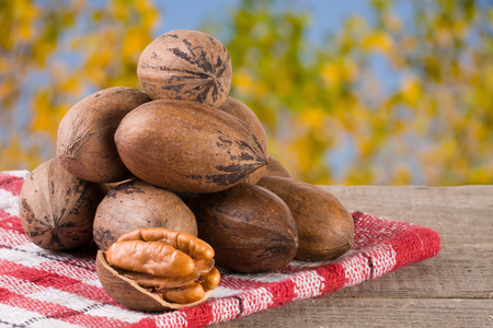 a bunch of pecan nuts on a wooden background. Stock Photo