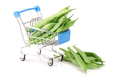 long bean: Green beans in mini shopping cart isolated on a white background