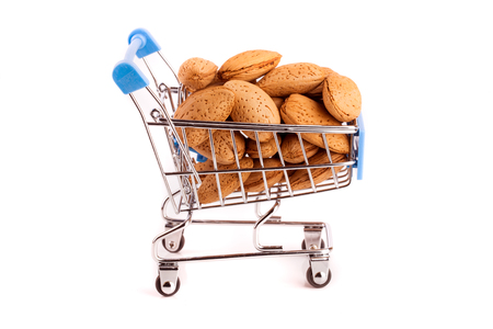 Shopping cart with almonds isolated on white background