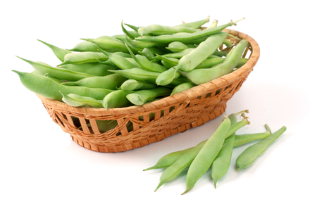 snap bean: Green beans in a wicker basket isolated on a white background