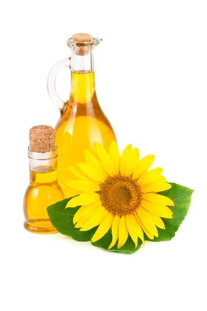 Sunflower oil and flower isolated on white background, Stock Photo