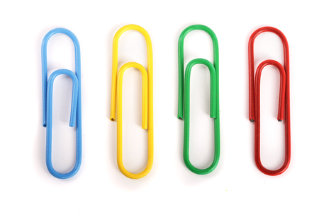 colored paper clips isolated on white background