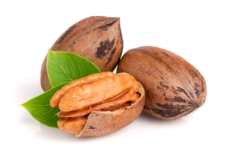 Three pecan with leaves isolated on white background