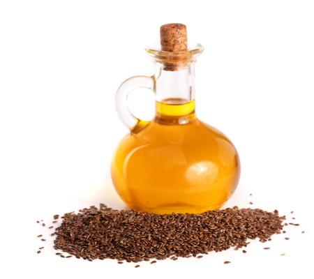 linseed oil with flax seeds isolated on white background.