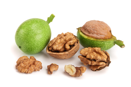 fresh walnuts in peel isolated on white background Stock Photo