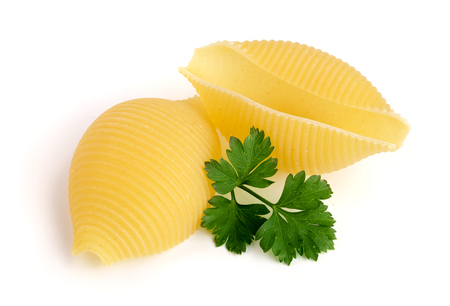 Italian lumaconi with leaf parsley isolated on white background. Lumache, snailshell shaped pasta Reklamní fotografie