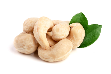 cashew nuts with leaf isolated on white background. macro.
