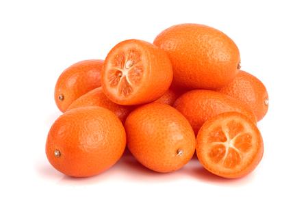 Cumquat or kumquat with half isolated on white background close up.