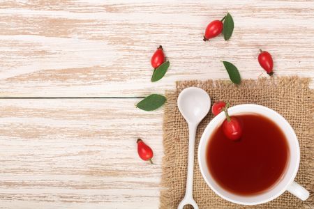 tea with rose hips and honey on a white wooden background with copy space for your text. Top view Banco de Imagens