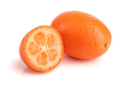 Cumquat or kumquat with half isolated on white background close up
