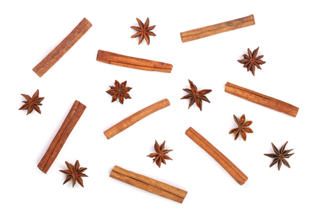 Composition of star anise and cinnamon sticks isolated on white. Abstract pattern flat lay, top view Banco de Imagens