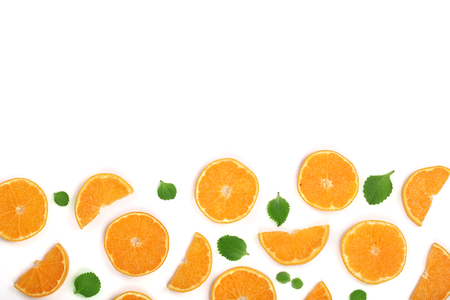 Slices of orange or tangerine with leaves isolated on white background with copy space for your text. Flat lay, top view Stock Photo