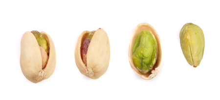 Pistachios isolated on white background, top view. Set or collection Foto de archivo