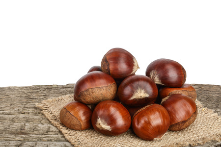 chestnut on the old wooden table with white background