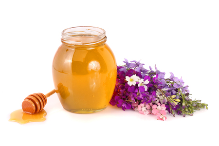 Jar of honey with wildflowers isolated on white background Stock Photo