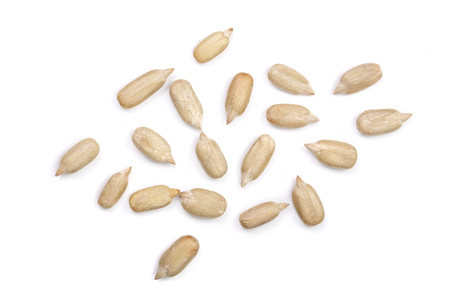 Peeled Sunflower seeds isolated on white background. Top view .