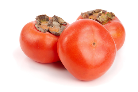 Persimmon fruit isolated on white background close-up. Stock Photo
