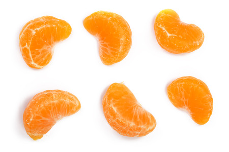 slices of mandarin or tangerine with leaves isolated on white background. Flat lay, top view. Fruit composition.