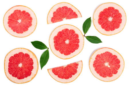 Grapefruit slices with leaves isolated on white background. Top view. Flat lay pattern Stock Photo