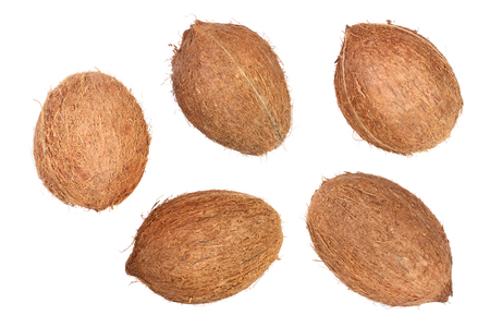 five whole coconut isolated on white background. Flat lay. Top view.