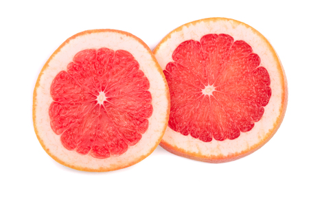 Grapefruit slices isolated on white background. Top view.