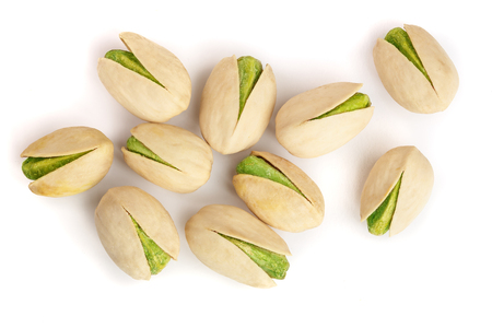 Pistachios isolated on white background, top view. Flat lay.
