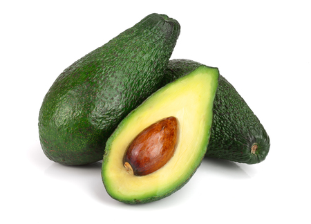whole and half avocado isolated on white background close-up. Top view.