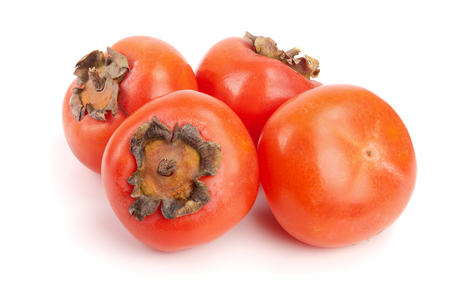 Persimmon fruit isolated on white background close-up Stock Photo