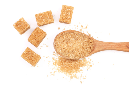 brown sugar in wooden spoon isolated on white background. Top view. Flat lay