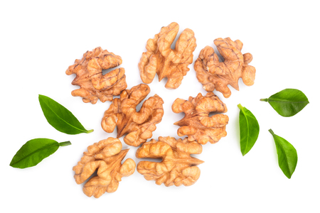 walnut kernels with leaves isolated on white background. Top view. Flat lay.